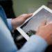 Businessman checking stock market on tablet