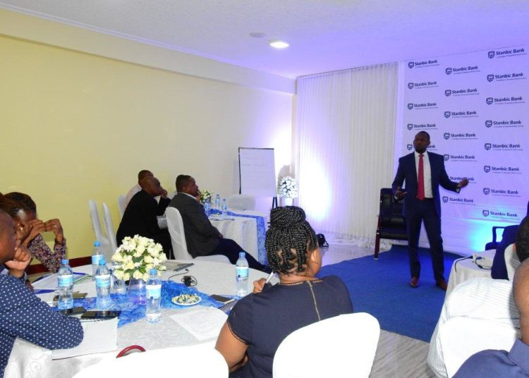 Stanbic Bank Head of Trading, Eric Chijoriga, speaking to the bank's customers during a Pensions Fund workshop held in Dodoma recently. Graced by the regulators from BoT and Social Security Regulatory Authority (SSRA), the workshop provided the customers with an understanding of Debt Market, Transactional banking with a focus on Custody Services and an opportunity to network and exchange ideas with industry peers and experts.