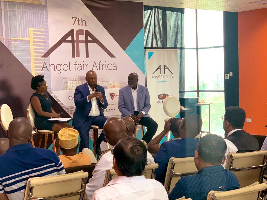 Bw. Andile Ngcaba (kati) akizungumza kwenye hafla ya saba ya Angel Fair Africa, kulia ni Bw. Ali Mufuruki
