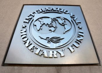 International Monetary Fund logo is seen outside the headquarters building during the IMF/World Bank spring meeting in Washington, U.S., April 20, 2018. REUTERS/Yuri Gripas